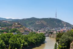 View across the River Mtkvari over the Old Town district towards the Tbilisi TV Tower on Mtatsminda mountain. Travel stock photography