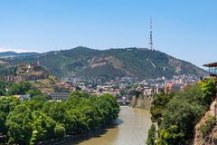 View across the River Mtkvari over the Old Town district towards the Tbilisi TV Tower on Mtatsminda mountain. Travel royalty free stock photo