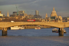 View across the River Thames from Hungerford Footbridge in sunset Stock Photos