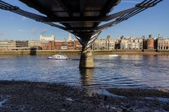 View across the River Thames from the South Bank underneath the Millennium Bridge, London. UK taken on 17 December 2012 royalty free stock image