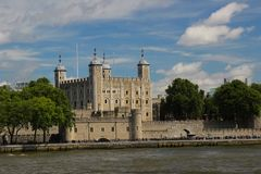 View across the River Thames at The Tower of London. Set on a blue and fluffy cloud sky Stock Photography