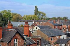 Manchester mill rooftops from Levenshulme with trees on skytline. royalty free stock photography