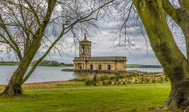 The view across Rutland Water in the UK from Normanton. Framed by two large trees in early autumn royalty free stock photo
