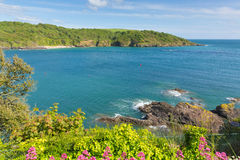 View across Salcome estuary to Sunny Cove secluded beach Devon UK Stock Photography