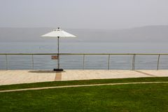 A view across the Sea of galilee from Tiberias to Golan. 3 May 2018 A view across the calm Sea of galilee from Tiberias to the Southern Golan Heights through a royalty free stock photos