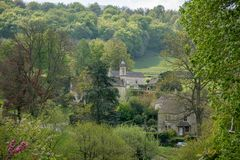 View across Sheepscombe with village church, The Cotswolds, Gloucestershire, United Kingdom. View across Sheepscombe with village church, St John the Apostle stock photography