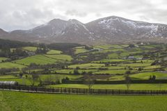 A view across the snow capped peaks of the mountains of Mourne in County Down Northern Ireland. On a dull midwinter afternoon Stock Images