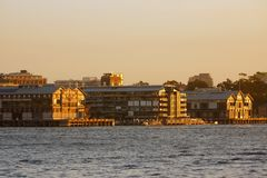 Walsh Bay Bond Stores at Sunset, Sydney Harbour, Australia. View across Sydney Harbour to the historic Walsh Bay bond stores at sunset, Sydney, NSW, Australia Royalty Free Stock Photography
