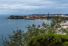 A view across Tenby peninsula at sunrise in Autumn Stock Photos