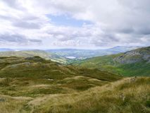 View across undulating hill to Lake Windermere Royalty Free Stock Photo