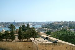 Valletta Battery CIty View. View across the Valetta cityscape past an old gun emplacement in Valletta, Malta Royalty Free Stock Photography