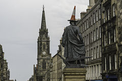 View of Adam Smith statue in Royal Mile street Edinburgh Royalty Free Stock Images