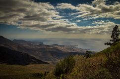 A view on Adeje from a mounain slope. Sea, sky, mountains royalty free stock photos