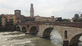 View of the Adige River as it passes through the houses and historical buildings of Verona in Italy,