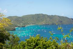 Yachts moored at a sheltered harbor in the windward islands Stock Images