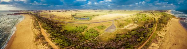 360 view aerial panorama of Bass Highway. 360 view aerial panorama of Bass Highway passing throughout meadows and pastures near the ocean in Victoria, Australia royalty free stock image