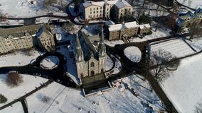 Aerial view of the Saint Thomas of Villanova Church on the Villanova University campus in Radnor township PA after snow. View of Aerial of the Saint Thomas of stock footage