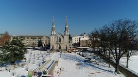 Aerial view of the Saint Thomas of Villanova Church on the Villanova University campus in Radnor township PA after snow. View of Aerial of the Saint Thomas of stock video footage