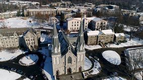 Aerial view of the Saint Thomas of Villanova Church on the Villanova University campus in Radnor township PA after snow. View of Aerial of the Saint Thomas of stock video