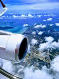 Scenic skyview from aeroplane over the island of Phuket Thailand. Gliding through the clouds and have a very beautiful sky view from the sky towards the island Stock Photography