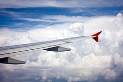 View from the aeroplane's window. On plane's wing and sky Royalty Free Stock Photos