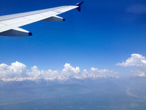 View from Aeroplane Window. Seen is the Himalayan mountain range covered with Ice Stock Images