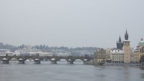 View from afar at Karlov Bridge and Vltava river in Prague in wi. Nter day Stock Photography