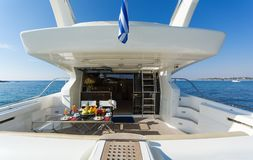 Aft-deck of a motor-yacht in the morning light. View of the aft-deck of a motor-yacht in the morning light Stock Image