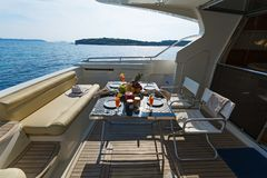 Aft-deck of a motor-yacht in the morning light. View of the aft-deck of a motor-yacht in the morning light Stock Photos