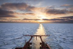 View from the aft of a research vessel crusing in ice during sun. Set Stock Photography