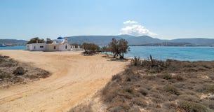 Marcello beach and Agios Fokas - Cyclades island - Aegean sea - Paroikia Pariki. View of Agios Fokas - Cyclades island - Aegean sea - Paroikia Parikia Paros stock image