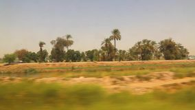 View of agricultural lands from train. View of country side from train Aswan Egypt Africa stock video