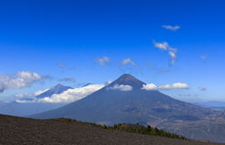 View on the Agua and Fuego Volcanoes. As seen from the slopes of the Pacaya Volcano stock photos