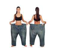 View ahead and behind thin girl with big pants Royalty Free Stock Photo