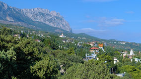 View on Ai-Petri Mount and Simeiz settlement in Crimea. View on Ai-Petri Mount and Simeiz settlement with Church of the Intercession in Crimea, Ukraine Royalty Free Stock Photography
