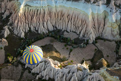 View of the air balloon flying over rock formation. In Cappadocia,Turkey Royalty Free Stock Photo