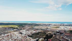 View from air on castle Sagunto near Valencia. Sunset views on ruined walls of old castle near seashore stock video footage