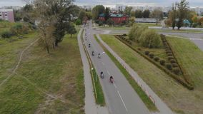 The view from the air on a lot of motorcyclists riding around the city stock video footage