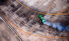 A view from the air racing drift car with a lot of smoke on the. Blurred speed track. In the trophy royalty free stock photos