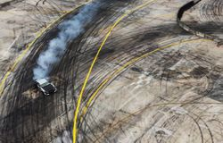 A view from the air racing drift car with a lot of smoke on the royalty free stock photography