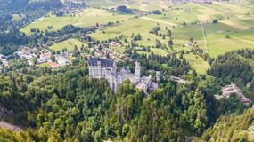 View from the air to the castle of Neuschwanstein castle in the Alpine mountains Stock Photography