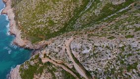 A view from the air to the coast and the sea near the city of Denia. District of Valencia, spring in Spain.  stock footage