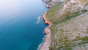 A view from the air to the coast and the sea near the city of Denia. District of Valencia, spring in Spain.  stock video