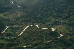 Aerial view of a winding road passing through the forest. A view from the air on a winding road passing through the forest Stock Photo