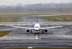 View on an aircraft. Which preparing to take off on foggy runway royalty free stock photos