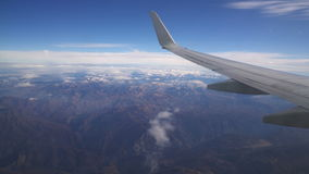 View from the aircraft to the mountains stock video footage