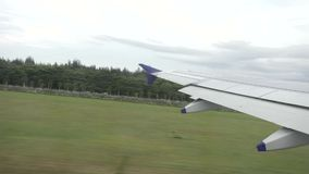 View from aircraft window at the time of take off stock footage