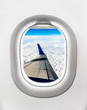 View of aircraft wing and clouds from airplane window Royalty Free Stock Images
