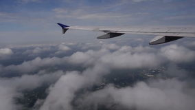 View of airline wing above clouds stock footage