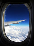 View from an airliner high above the clouds stock photo